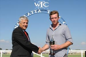 Matt Laure being presented the winning trainer's cup for Tigerland